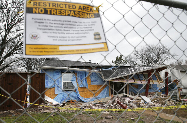 """FILE - This Feb. 28, 2018, file photo shows the home where Linda """"Michellita"""" Rogers, 12, died in a gas explosion in Dallas, several days earlier. On Tuesday, Jan. 12, 2021, National Transportation Safety Board officials said a natural gas explosion at the home came after an energy company failed to find a damaged line despite two nearby homes being destroyed in gas-related fires on the two previous days. (Vernon Bryant/The Dallas Morning News via AP, File)"""