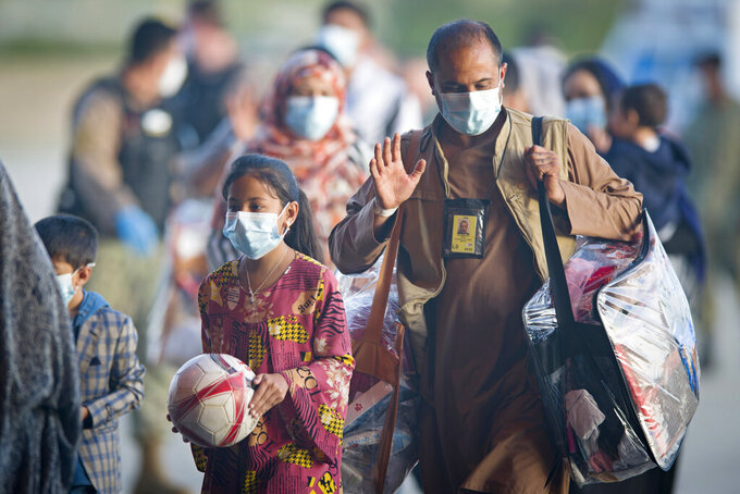 Evacuees from Afghanistan arrive after disembarking from a U.S. airforce plane at the Naval Station in Rota, southern Spain, Tuesday Aug. 31, 2021. The United States completed its withdrawal from Afghanistan late Monday, ending America's longest war.(AP Photo/ Marcos Moreno)