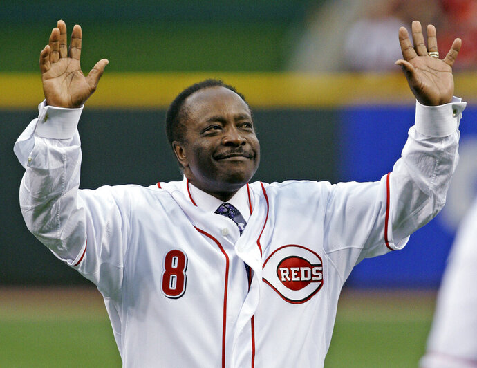FILE - In this Wednesday, April 7, 2010, file photo, Cincinnati Reds Hall of Fame second baseman Joe Morgan acknowledges the crowd after throwing out a ceremonial first pitch prior to the Reds' baseball game against the St. Louis Cardinals, in Cincinnati. Hall of Fame second baseman Joe Morgan has died. A family spokesman says he died at his home Sunday, Oct. 11, 2020, in Danville, California. (AP Photo/Al Behrman)
