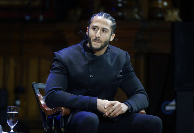 FILE - In this Oct. 11, 2018, file photo, former NFL football quarterback Colin Kaepernick attends the W.E.B. Du Bois Medal ceremonies at Harvard University in Cambridge, Mass. Recent societal events, including of course the death of George Floyd,  appear to be leading to major changes on the sports front. The kind of changes Kaepernick sought four years ago when he began kneeling. (AP Photo/Steven Senne, File)
