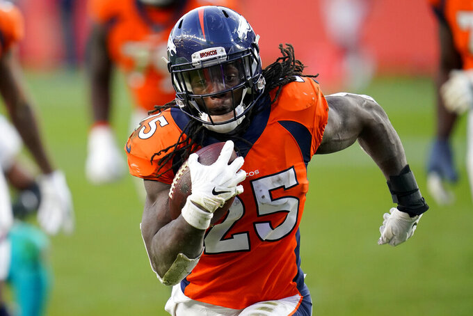 FILE - In this Nov. 22, 2020, file photo, Denver Broncos running back Melvin Gordon (25) runs for his second touchdown against the Miami Dolphins during the second half of an NFL football game in Denver. Gordon will likely avoid NFL discipline after his drunken driving charge was dismissed and he pleaded guilty in Denver County Court on Wednesday, March 10, 2021, to lesser charges of excessive speeding and reckless driving. (AP Photo/David Zalubowski, File)