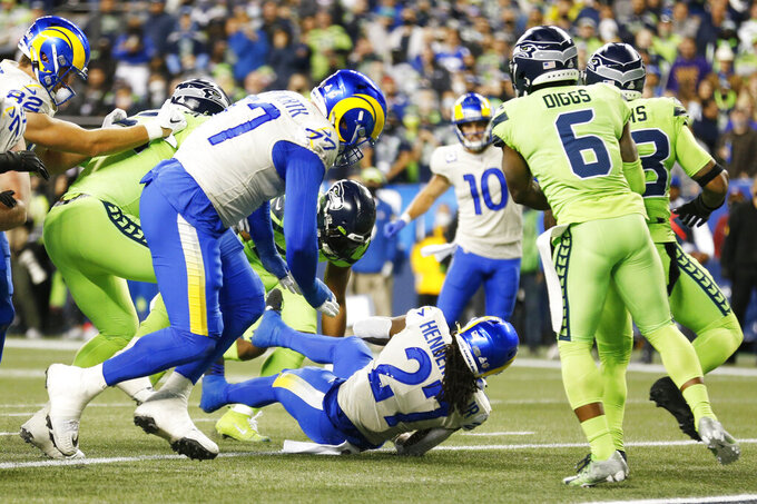 Los Angeles Rams running back Darrell Henderson (27) scores a touchdown against the Seattle Seahawks during the second half of an NFL football game, Thursday, Oct. 7, 2021, in Seattle. (AP Photo/Craig Mitchelldyer)