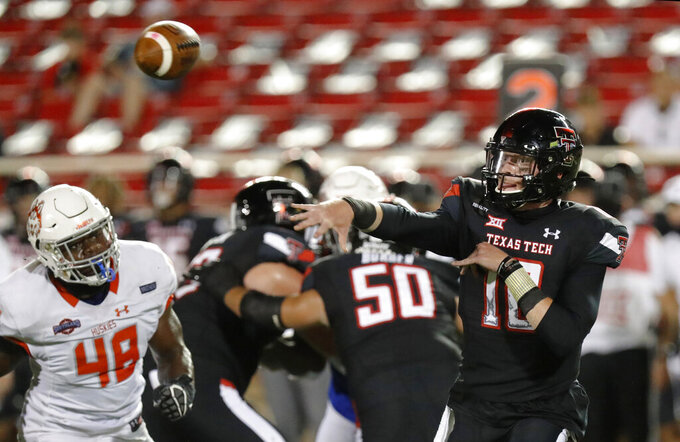Texas Tech's Alex Bowman throws a pass late in the second half of the team's NCAA college football game against Houston Baptist, Saturday, Sept. 12, 2020, in Lubbock, Texas. (AP Photo/Mark Rogers)