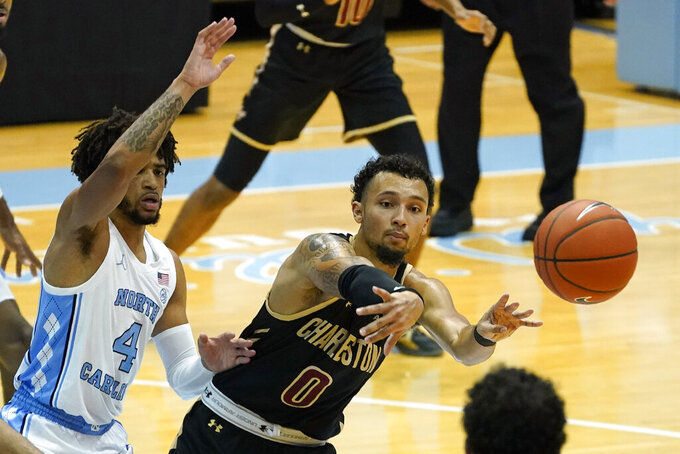 North Carolina guard R.J. Davis (4) guards College of Charleston guard Payton Willis (0) during the second half of an NCAA basketball game in Chapel Hill, N.C., Wednesday, Nov. 25, 2020. (AP Photo/Gerry Broome)