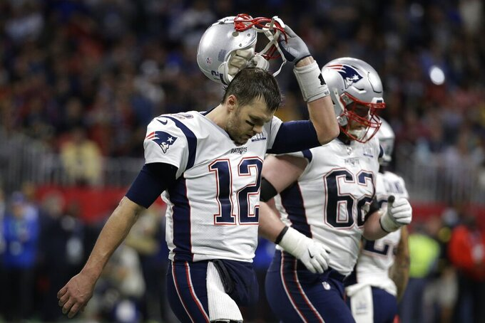 New England Patriots' Tom Brady (12) and Joe Thuney (62) walk off the field during the first half of the NFL Super Bowl 53 football game against the Los Angeles Rams, Sunday, Feb. 3, 2019, in Atlanta. (AP Photo/Mark Humphrey)