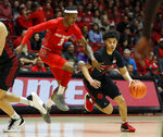 San Diego State guard Trey Pulliam (4) dribbles around New Mexico guard Keith McGee (3) during the first half of an NCAA college basketball game on Wednesday, Jan. 29, 2020 in Albuquerque, N.M. (AP Photo/Andres Leighton)