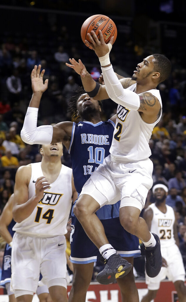 VCU's Marcus Evans (2) drives past Rhode Island's Cyril Langevine (10) during the first half of an NCAA college basketball game in the Atlantic 10 men's tournament Friday, March 15, 2019, in New York. (AP Photo/Frank Franklin II)