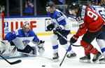 Finland's Miro Heiskanen, center, and Finland's goalkeeper Harri Sateri, left, try to stop Canada's Ryan Nugent-Hopkins, right, during the Ice Hockey World Championships group B match between Canada and Finland at the Jyske Bank Boxen arena in Herning, Denmark, Saturday, May 12, 2018. (AP Photo/Petr David Josek)
