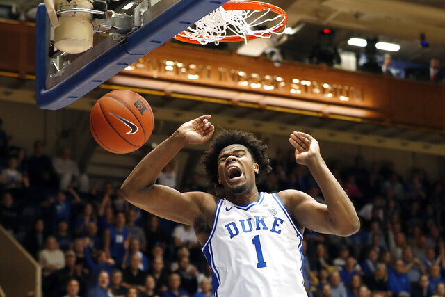 FILE - In this Dec. 31, 2019, file photo, Duke center Vernon Carey Jr. dunks against Boston College during the first half of an NCAA basketball game in Durham, N.C. Carey Jr. was selected to the Associated Press All-ACC team selected Tuesday, March 10, 2020.  Carey Jr. was also named AP ACC Player of the Year and Newcomer of the Year in the ACC. (AP Photo/Gerry Broome, File)