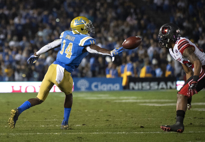 UCLA wide receiver Theo Howard, left, can't catch a pass as Utah defensive back Julian Blackmon looks on during the first half of an NCAA college football game Friday, Oct. 26, 2018, in Pasadena, Calif. (AP Photo/Kyusung Gong)