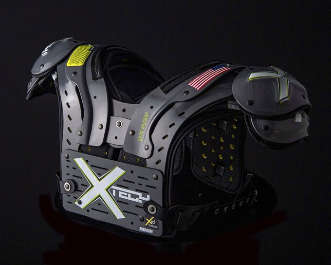 In this undated photo provided by XTECH, XTECH custom shoulder pads are displayed. XTECH co-founders Broderick and Monica have found ways to get shoulder pads out to NFL, college and high school players in the midst of the coronavirus pandemic. (William Hauser Photography/XTECH via AP)