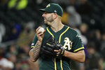 Oakland Athletics starting pitcher Mike Fiers looks toward second base as he works the ball during the fifth inning of a baseball game against the Seattle Mariners, Friday, Sept. 27, 2019, in Seattle. (AP Photo/Ted S. Warren)