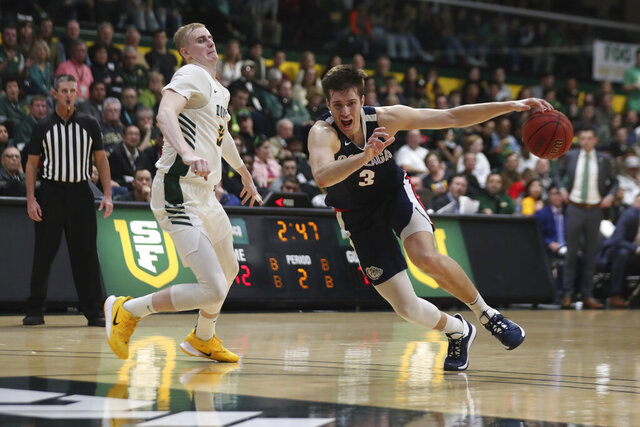 Gonzaga forward Filip Petrusev (3) drives against San Francisco forward Remu Raitanen (11) during the second half of an NCAA college basketball game in San Francisco, Saturday, Feb. 1, 2020. (AP Photo/Jed Jacobsohn)