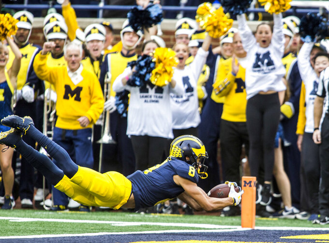 Michigan wide receiver Ronnie Bell (8) makes a 22-yard touchdown reception in the second quarter of an NCAA college football game against Maryland in Ann Arbor, Mich., Saturday, Oct. 6, 2018. (AP Photo/Tony Ding)