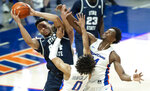 Boise State guard Marcus Shaver, Jr. and teammate Abu Kigab pressure Utah State guard Marco Anthony during the second half of an NCAA college basketball game Wednesday, Feb. 17, 2021 at ExtraMile Arena in Boise, Idaho. (Darin Oswald/Idaho Statesman via AP)