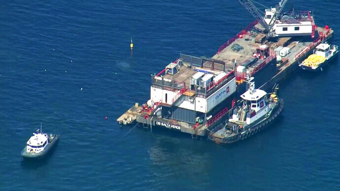 This photo from video provided by KABC-TV shows divers resuming their search for the final missing victim who perished in a boat fire off the Southern California coast Wednesday, Sept. 11, 2019. The victim is one of 34 who died at sea last week near Santa Cruz Island when the dive boat Conception burned and sank on Sept. 2. Santa Barbara County Sheriff's Lt. Erik Raney says salvage efforts to recover the Conception also resumed Wednesday. (KABC-TV via AP)