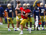 Jack Coan throws the ball during Notre Dame NCAA college football practice in South Bend, Ind., Thursday, Aug. 12, 2021. (Michael Caterina/South Bend Tribune via AP)