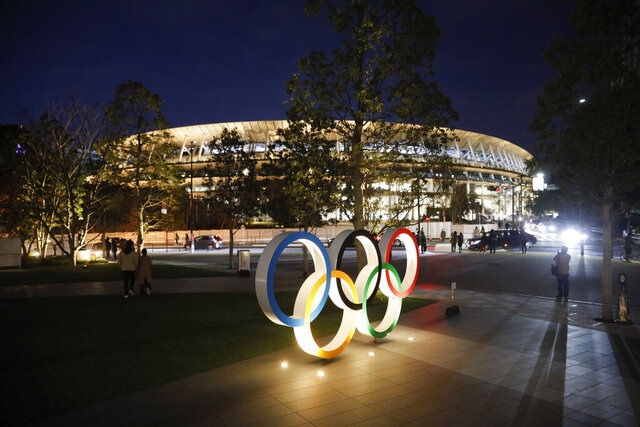 FILE - In this Dec. 15, 2019, file photo, the Olympic rings stand near the new National Stadium Sunday, Dec. 15, 2019, in Tokyo. The stadium is officially completed. Tokyo's Olympic tickets continue to be very hard to find — particularly in Japan. Organizers on Wednesday, Dec. 18, said there were 23 million tickets requested in the latest lottery for Japan residents only. The bad news is that only 1 million tickets were available. Which means most came away empty handed. (AP Photo/Jae C. Hong, File)