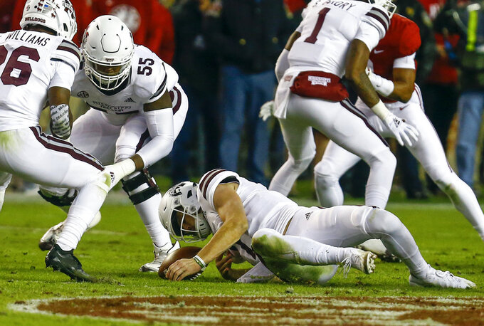 Mississippi State quarterback Nick Fitzgerald (7) dives on a fumbled snap during the second half of an NCAA college football game against Alabama, Saturday, Nov. 10, 2018, in Tuscaloosa, Ala. (AP Photo/Butch Dill)
