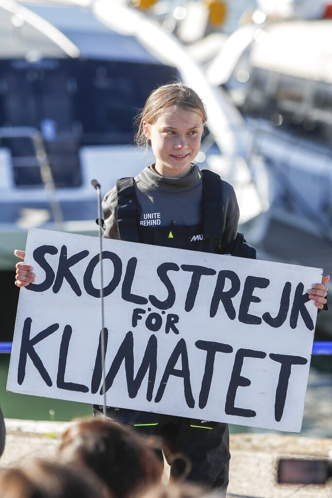 Climate activist Greta Thunberg holds a
