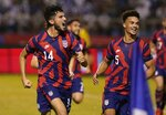 United States' Ricardo Pepi, left, celebrates scoring his side's second goal against Honduras during a qualifying soccer match for the FIFA World Cup Qatar 2022, in San Pedro Sula, Honduras, Wednesday, Sept. 8, 2021. (AP Photo/Moises Castillo)