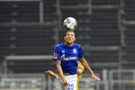 Schalke's Amine Harit heads the ball during the German Bundesliga soccer match between Borussia Dortmund and Schalke 04 in Dortmund, Germany, Saturday, May 16, 2020. The German Bundesliga becomes the world's first major soccer league to resume after a two-month suspension because of the coronavirus pandemic. (AP Photo/Martin Meissner, Pool)