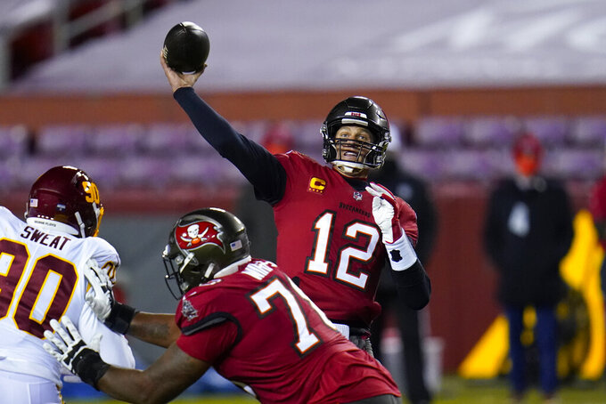 Tampa Bay Buccaneers quarterback Tom Brady (12) throws a touchdown pass to wide receiver Antonio Brown during the first half of an NFL wild-card playoff football game against the Washington Football Team, Saturday, Jan. 9, 2021, in Landover, Md. (AP Photo/Julio Cortez)