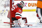 New Jersey Devils goaltender Mackenzie Blackwood blocks a shot during the first period of the team's NHL hockey game against the New York Rangers, Thursday, Oct. 17, 2019, in Newark, N.J. (AP Photo/Kathy Willens)