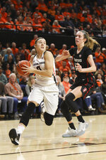 Oregon State's Mikayla Pivec (0) slips around Stanford's Lexie Hull (12) for a layup during the first half of an NCAA college basketball game in Corvallis, Ore., Sunday, Jan. 19, 2020. (AP Photo/Amanda Loman)