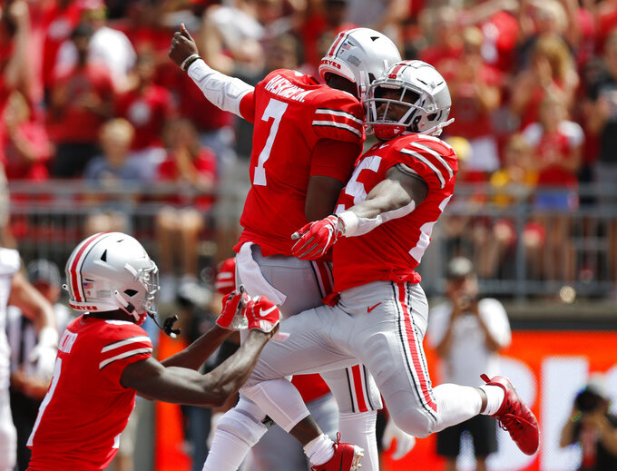 Ohio State running back Mike Weber, right, and quarterback Dwayne Haskins celebrate Weber's touchdown against Oregon State during the first half of an NCAA college football game Saturday, Sept. 1, 2018, in Columbus, Ohio. (AP Photo/Jay LaPrete)