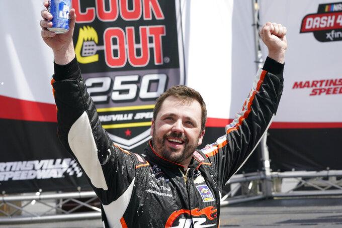 Josh Berry celebrates winning the rain delayed NASCAR Xfinity Series auto race at Martinsville Speedway in Martinsville, Va., Sunday, April 11, 2021. (AP Photo/Steve Helber)