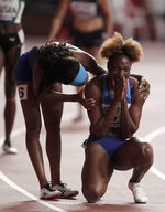 Nia Ali, of the United States is congratulated by Kendra Harrison after winning the gold medal in the women's 100 meter hurdles final at the World Athletics Championships in Doha, Qatar, Sunday, Oct. 6, 2019. (AP Photo/Nariman El-Mofty)