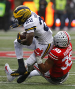 Ohio State linebacker Malik Harrison, right, tackles Michigan running back Karan Higdon during the first half of an NCAA college football game Saturday, Nov. 24, 2018, in Columbus, Ohio. (AP Photo/Jay LaPrete)