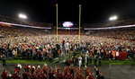 Iowa State fans celebrate on the field after an NCAA college football game against West Virginia, Saturday, Oct. 13, 2018, in Ames, Iowa. (AP Photo/Charlie Neibergall)