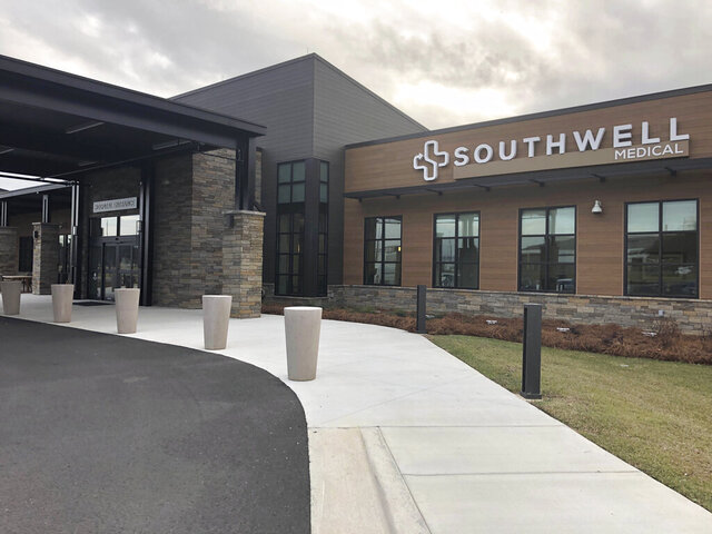 In this Jan. 23, 2020 photo, the new $52 million Southwell Hospital opened its doors in Adel, Ga. In 2017 officials shut down the old hospital after it had trouble recruiting doctors, had an outdated building and a sizable patient population with no health insurance. The new hospital opened its doors in October. But there was one catch: there was no emergency room, a major financial drain on the old hospital. (AP Photo/ Sudhin S. Thanawala)