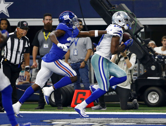 New York Giants' Deandre Baker (27) defends as Dallas Cowboys wide receiver Amari Cooper (19) catches a pass for a touchdown in the first half of a NFL football game in Arlington, Texas, Sunday, Sept. 8, 2019. (AP Photo/Ron Jenkins)