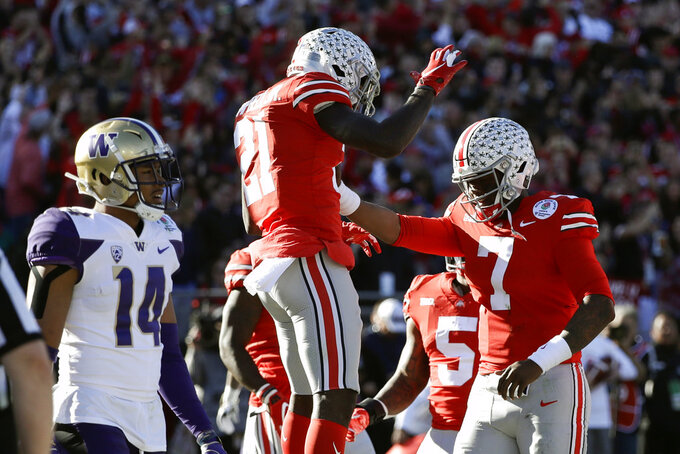 Ohio State wide receiver Parris Campbell, center, celebrates with quarterback Dwayne Haskins (7) after scoring a touchdown during the first half of the Rose Bowl NCAA college football game against Washington, Tuesday, Jan. 1, 2019, in Pasadena, Calif. (AP Photo/Jae C. Hong)