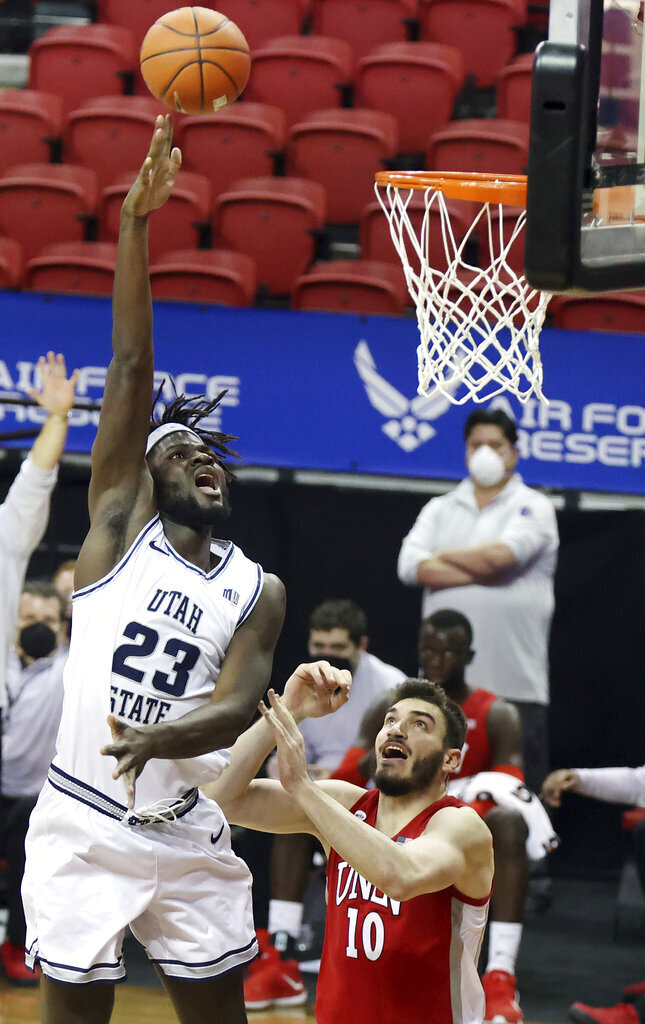 Utah State center Neemias Queta (23) shoots as UNLV forward Edoardo Del Cadia (10) defends during the first half of an NCAA college basketball game in the quarterfinals of the Mountain West Conference men's tournament Thursday, March 11, 2021, in Las Vegas. (AP Photo/Isaac Brekken)