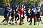 Houston Texans quarterback Deshaun Watson (4) gathers the offense in a huddle during an NFL training camp football practice Tuesday, Aug. 25, 2020, in Houston. (Brett Coomer/Houston Chronicle via AP, Pool)