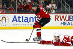New Jersey Devils left wing Taylor Hall (9) has his pass blocked by Detroit Red Wings defenseman Danny DeKeyser during the second period of an NHL hockey game Saturday, Nov. 17, 2018, in Newark, N.J. (AP Photo/Adam Hunger)