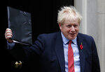 Britain's Prime Minister Boris Johnson leaves 10 Downing Street on his way to the Houses of Parliament in London, Tuesday, Oct. 29, 2019. Britain appeared on course Tuesday for an early general election that could break the country's political deadlock over Brexit, after the main opposition Labour Party said it would agree to the government's request to send voters to the polls in December. (AP Photo/Frank Augstein)