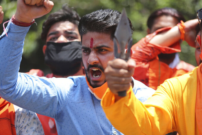 FILE - In this Wednesday, June 17, 2020, file photo, activists of Rashtriya Bajrang Dal shout slogans during a protest against the Chinese government in Jammu, India. As the escalating and bitter military standoff between India and China protracts following their bloodiest confrontation in decades in the Ladakh region in 2020, experts warn the two nuclear-armed countries can unintentionally slide into a war over the roof of the world. Both the Asian giants have accused the other of fresh provocations, including allegations of soldiers crossing into each other's territory this week and vowed to protect their territorial integrity. (AP Photo/Channi Anand, File)