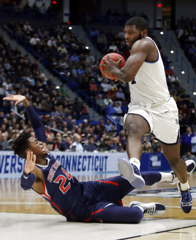 Villanova's Eric Paschall, right, drives against St. Mary's Malik Fitts (24) during the second half of a first round men's college basketball game in the NCAA Tournament, Thursday, March 21, 2019, in Hartford, Conn. (AP Photo/Elise Amendola)