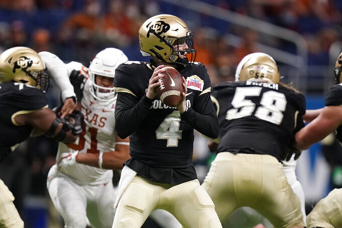 Colorado quarterback Sam Noyer (4) looks for a receiver during the first half against Texas in the Alamo Bowl NCAA college football game Tuesday, Dec. 29, 2020, in San Antonio. (AP Photo/Eric Gay)