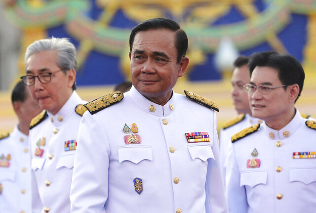 FILE - In this July 16, 2019, file photo, Thailand's Prime Minister Prayuth Chan-ocha attends a group photo with his cabinet members at the government house in Bangkok. On Thursday, Aug. 6, 2020, Prayuth reshuffled his Cabinet, with an experienced banker taking over the post of finance minister.  (AP Photo/Sakchai Lalit, File)