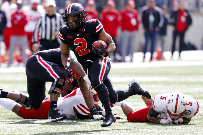 FILE- In this Saturday, Nov. 3, 2018, file photo, Ohio State running back J.K. Dobbins rushes against Nebraska during an NCAA college football game in Columbus, Ohio. Ohio State visits Michigan State needing a win to stay on track for a Big Ten East showdown with Michigan in two weeks. (AP Photo/Jay LaPrete, File)