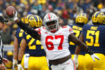 Ohio State defensive lineman Robert Landers (67) celebrates recovering a Michigan fumble in the first half of an NCAA college football game in Ann Arbor, Mich., Saturday, Nov. 30, 2019. (AP Photo/Paul Sancya)