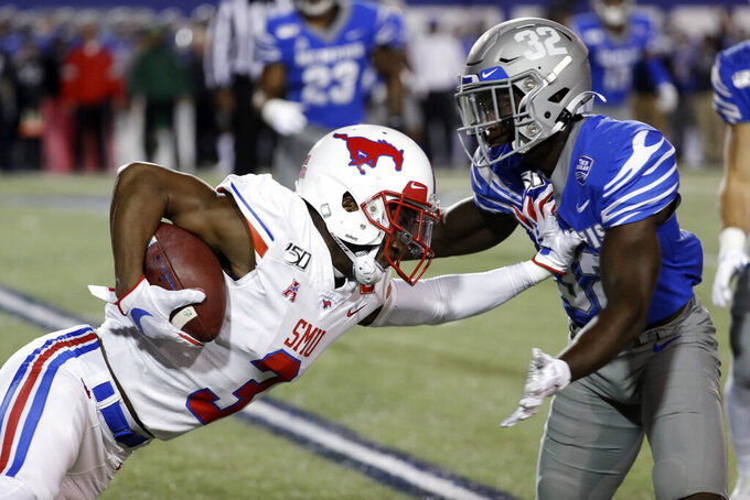 SMU wide receiver James Proche (3) carries the ball against Memphis defensive back Jacobi Francis (32) in the first half of an NCAA college football game Saturday, Nov. 2, 2019, in Memphis, Tenn. (AP Photo/Mark Humphrey)