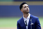 Former Milwaukee Brewers player Ryan Braun looks up to the crowd as he gives his retirement speech before a baseball game between the Brewers and the New York Mets, Sunday, Sept. 26, 2021, in Milwaukee. (AP Photo/Aaron Gash)