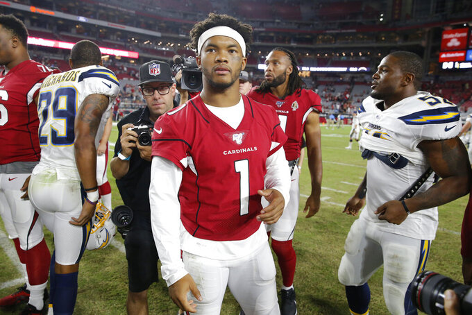 Arizona Cardinals quarterback Kyler Murray (1) stands at midfield after an NFL preseason football game ageists the Los Angeles Chargers, Thursday, Aug. 8, 2019, in Glendale, Ariz. (AP Photo/Rick Scuteri)